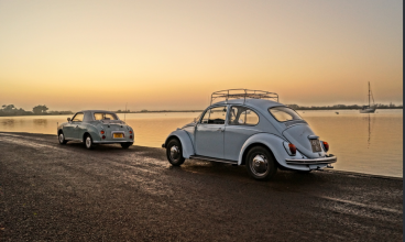 Blue VW Beetle at sunset in emsworth